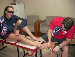 Dr. Keith applying K-Laser to U.S. Olympic Triathlon Team Member Julie Ertel